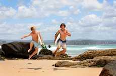 "Seb Douglass and Kyzak White are ""Stoked"" with the swell running through greenmount beach. Photo Blainey Woodham / Daily News"
