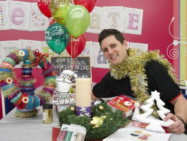 Anthony Vine with a selection of make your own Christmas decorations at Spotlight.