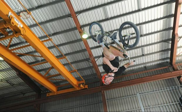 Rock Off Indoor Park opening - James Owen-Boundy pulls off a flair manoeuvre on his bike in the park.