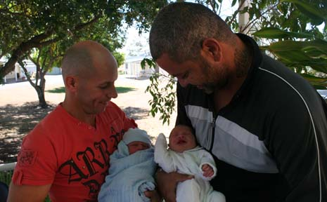 LUCKY DUO: Mark Nancarrow with son Laken Cooper and Micky Hamilton with daughter Matilda Grace. The babies were born on the 12th of the 12th, 2012.