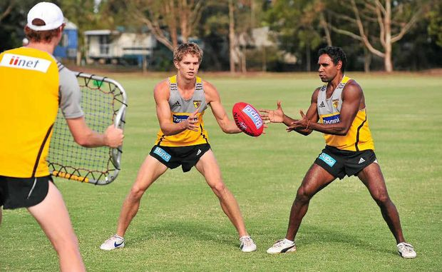 Hawthorn AFL players train at Fisherman's Road, Maroochydore, yesterday.