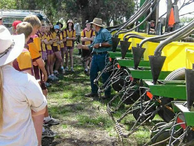 ESSENTIAL LEARNING: Dalby State High School Year 9 and 11 students hear from the school's farm manager David Gherasi.