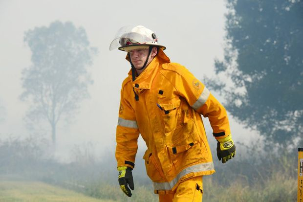 A GRASS fire is slowing traffic on the Bruce Hwy at Bells Creek.