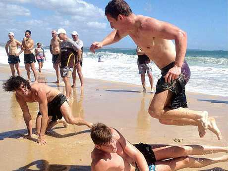 ALL A'FLUTTER: While Brendan Whitecross (in yellow) and Luke Bruest (inset) duke it out, the rest of the Hawks fly at Mooloolaba Beach yesterday.