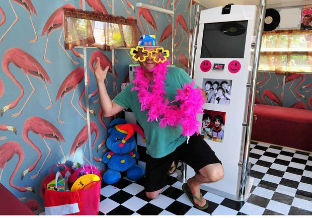 IT'S THE VAN, MAN: Chris and Anita Lee ham it up in their colourful mobile photo booth.