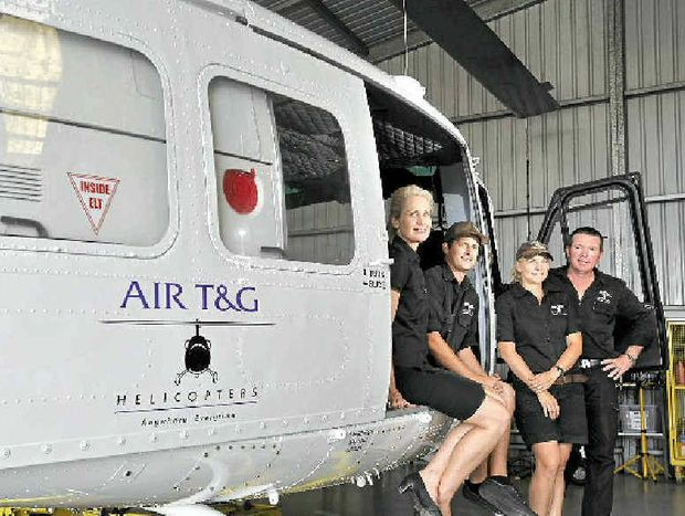 CHOPPER CREW: Sandy McGauley, Wayne McIntosh, Georgie and Tim Latimer of AIR T&G; Ballina, with the new Bell Huey helicopter to fight bushfires and flood relief.