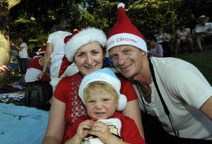 Lismore Carols Riverside park 16-12-12. Having a great night at the Lismore Carol's last night Mum Kylie, 2yrs Kaden, and Dad Matt Everman, of Goonellabah. Photo Doug Eaton / The Northern Star