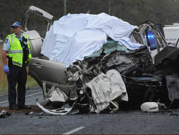 Police investigate a crash that killed five people on the Bruce Hwy north of Howard.