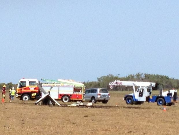Emergency crews and a crane are at the scene of a fatal plane crash near Burrum Heads.