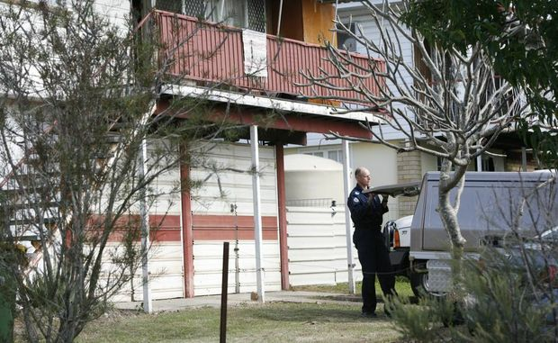 File photo of police forensic investigators on scene at an Alice Street property in Goodna.