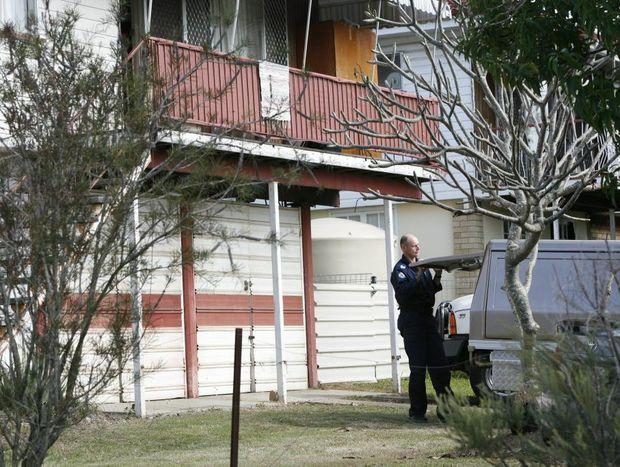 File photo of police forensic investigators on scene at an Alice Street property in Goodna.