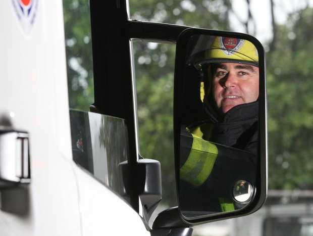 Senior firefighter Jason Recliner checking his mirrors. Photo Blainey Woodham / Daily News