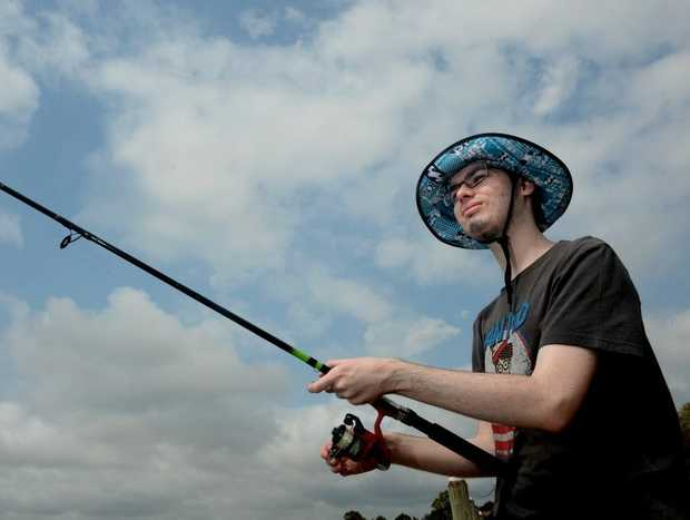Tim Dreghorn is fishing at Kennedy Dr boat ramp. Photo: John Gass / Daily News