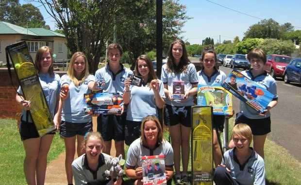GENEROUS: Students from the Year 9 Business class at Kingaroy State High School with the gifts they are donating to the Kids in Care Christmas Appeal.