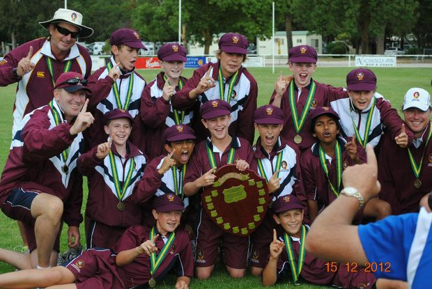 HAPPY TIMES: The Queensland team celebrates securing joint victory at the School Sport Australia 12 Years Boys Cricket Championships in South Australia.