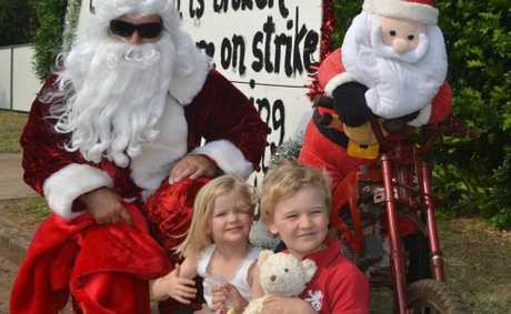 Enjoying seeing the man in the red cape at Surat's Santa Run on Sunday are Ella and Archie McLean.