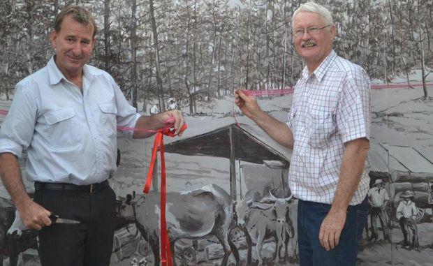 Maranoa Mayor Rob Loughnan and Yuleba Development Group president Paul Masson cut the ribbon to open the main street murals in Yuleba on Satuday.