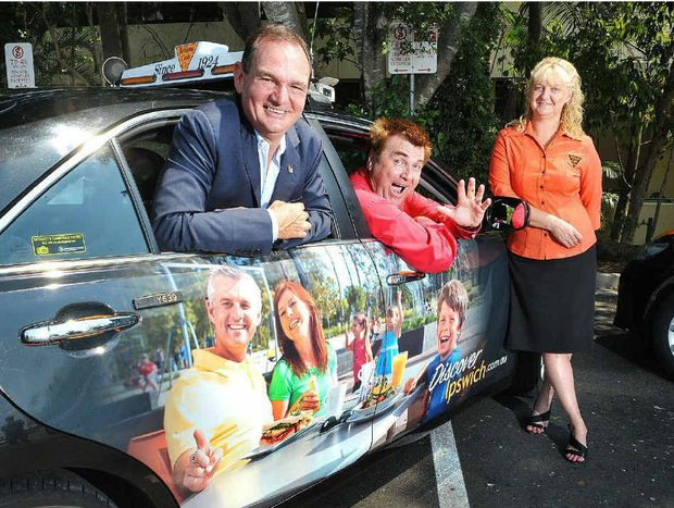 IPSWICH ALL OVER: Ipswich Mayor Paul Pisasale (left), Cr David Pahlke and Debbie Morrison, the Ipswich manager of Yellow Cabs, with one of the taxis emblazoned with Discover Ipswich signs.