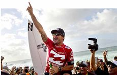 Joel Parkinson celebrates after claiming his first surfing world title at Oahu, Hawaii, last week. The former Caloundra surfer had been runner-up four times.