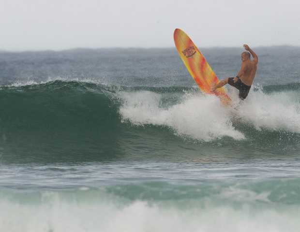 Surfing on a rainy morning at The Pass in Byron Bay. Photo Jay Cronan