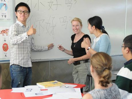 Kimberly gets an Aussie thumbs up from Chinese teacher Joshua Wang after successfully writing in Chinese.