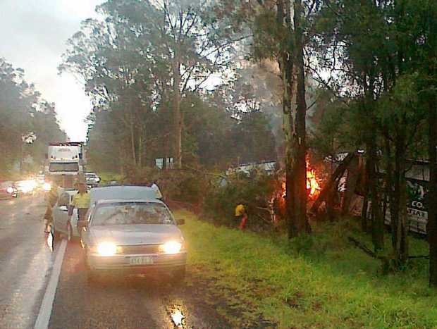 The fiery aftermath of the Warrego Hwy collision.