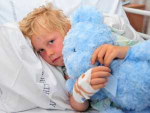 Lochlan Johns, 6, recovering in Nambour Hospital after stitches to the back of his head and superficial facial injuries after dog bites at Buddina Beach.
