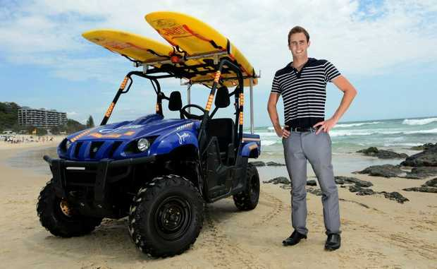 Michael Sullivan with the new ATV at Currumbin SLSC. Photo: John Gass / Daily News