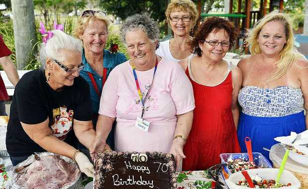 PARTY TIME: Volunteers congratulate Nancy Piggott on her birthday.
