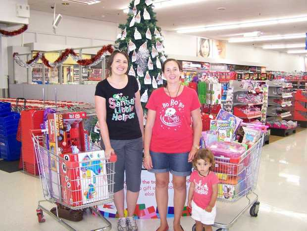 Erin McGovern and Amy Williamson show off the haul donated to the wishing tree. Photo: Contributed