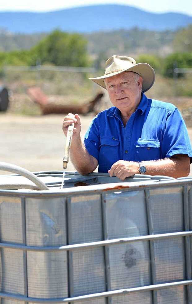 Gympie water supply councillor Larry Friske helps out yesterday.