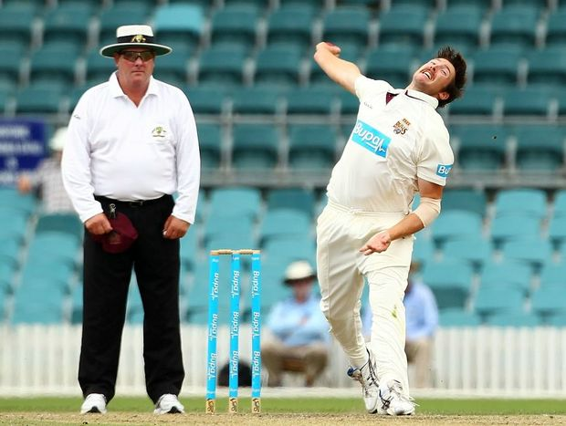 Luke Feldman of the Bulls bowls during day two of the Sheffield Shield match between the New South Wales Blues and the Queensland Bulls at Manuka Oval on November 28, 2012 in Canberra, Australia.