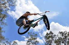 SUPER FLY: Warren Elbourne, 18, demonstrates his BMX skills with some high-flying tricks.
