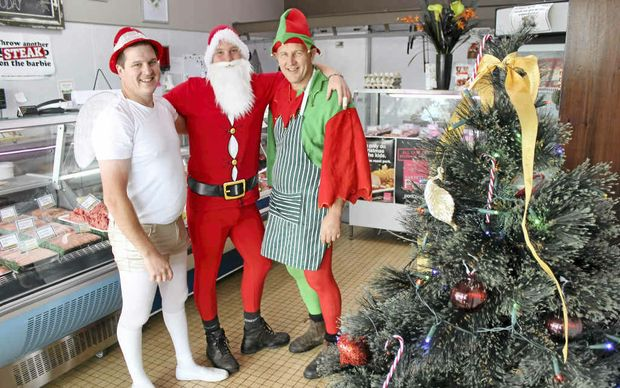 CHRISTMAS SPIRIT: Alstonville Quality Meats butchers (from left) Ashley Thomson, Will Finlay and Bruce Hall dressed up themselves as well as the business for the chamber of commerce competition.