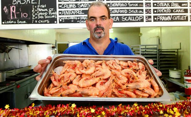 Michael Doblo has plenty of prawns – one of the most popular meats on the menu at Christmas – ready for seafood lovers.