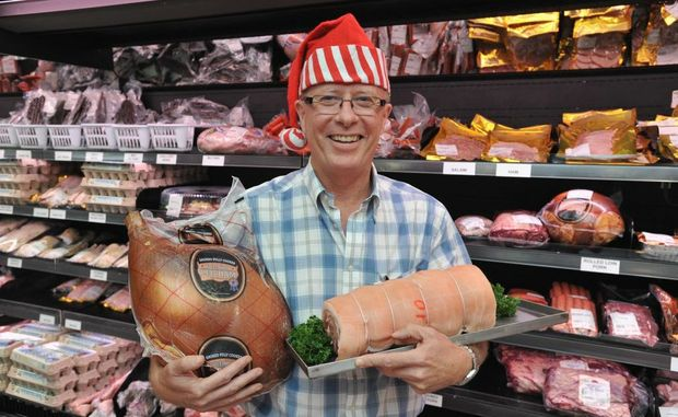 Dr Shaun Rudd with an 8kg leg ham and a rolled loin of pork at Kawungan Quality Meats.