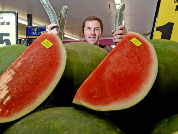 Justin Clinch from Tweed Heads Fruit and Vegetable shop with some nine cent cucumbers. Photo: Blainey Woodham / Daily News