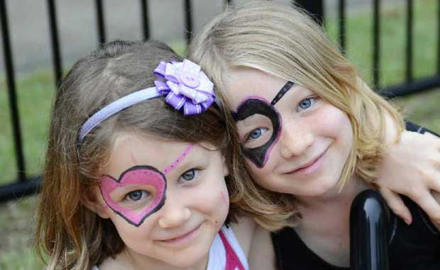 Emily, 5, and Leah, 8, Henderson get into the face painting at Carols on the Grass at the St Stephen's Presbyterian Church at South Grafton. Photos: Debrah Novak