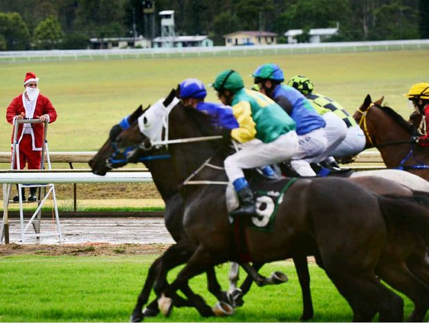 SANTA'S WATCHING: The horses launch from the starting gates under the watchful eye of Santa (race starter Grant Greasley) at the Ipswich racetrack last Friday. The last race of the day was won by Sweet And Vicious.