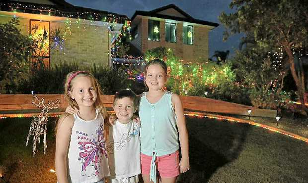 LOVING MEMORY: Madi, Sam and Jess Barker with the Christmas lights at Rainsford Place, Buderim. Resident Cathy Miles (inset) died recently.