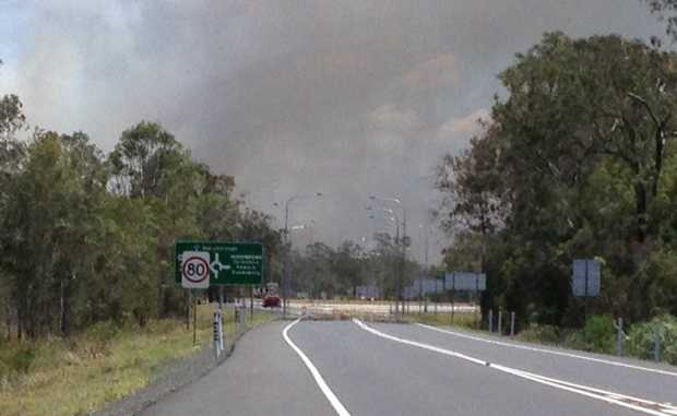 A bushfire has cut the Maryborough-Hervey Bay Rd.