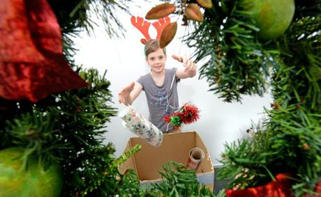 Ainslee Hunter box's up some christmas gear on boxing day Photo: Blainey Woodham / Daily News