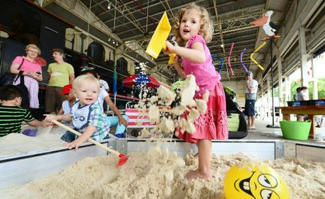 Sophie West, 3 and Ben West, 1, enjoyed the beach theme activities at the Railway Workshops Museum. Photo: David Nielsen / The Queensland Times