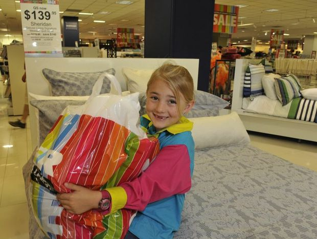 Youngster Sophie Aylmore with a bag of goodies at Myer Toowoomba.