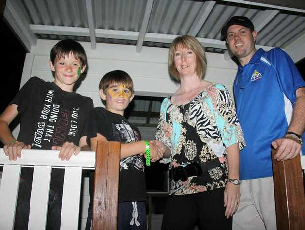 Braedon and Liam Vandermaal receive their cubby prize from Deanne Learoyd and Jon Weller of Apex at the Santa Fair on Saturday.