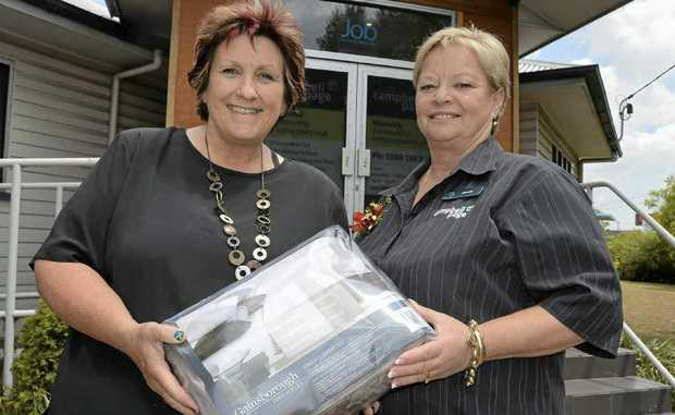 The crew at Campbell Page donated much-needed bed sheets to the Warwick Safe Haven. Bette Bonney accepts the sheets from Campbell Page business manager Jennie Porter.