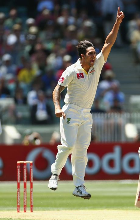 Mitchell Johnson of Australia takes the wicket of Prasanna Jayawardene of Sri Lanka during day one of the Second Test match between Australia and Sri Lanka at Melbourne Cricket Ground on December 26 in Melbourne.