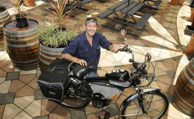 Alan Jones and his motorised bush bike he has built.