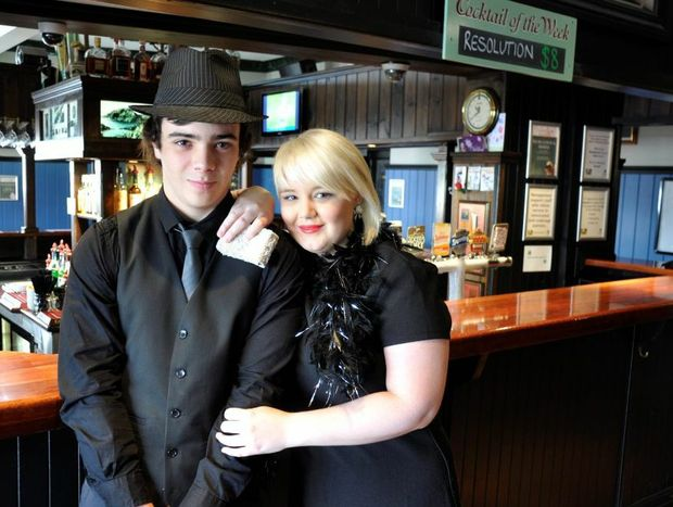 """Irish Club Hotel staff Jeremy Harris (left) and Lisa Schrodter prepare for the """"Black and Bling"""" New Year's Eve bash."""