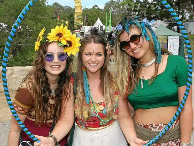 CIRCLE OF FRIENDS: Rosie Rayner, Tara Naismith Thompson, and Kalyani Mumtaz dress up for Day Two of Woodford Folk Festival.
